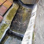Tower parapet gutter – Failed patch repair and decayed base
